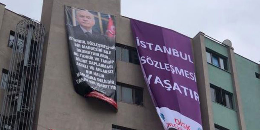 Kocaeli'de aynı binada afişler savaşı! Bu kez MHP'den hamle geldi