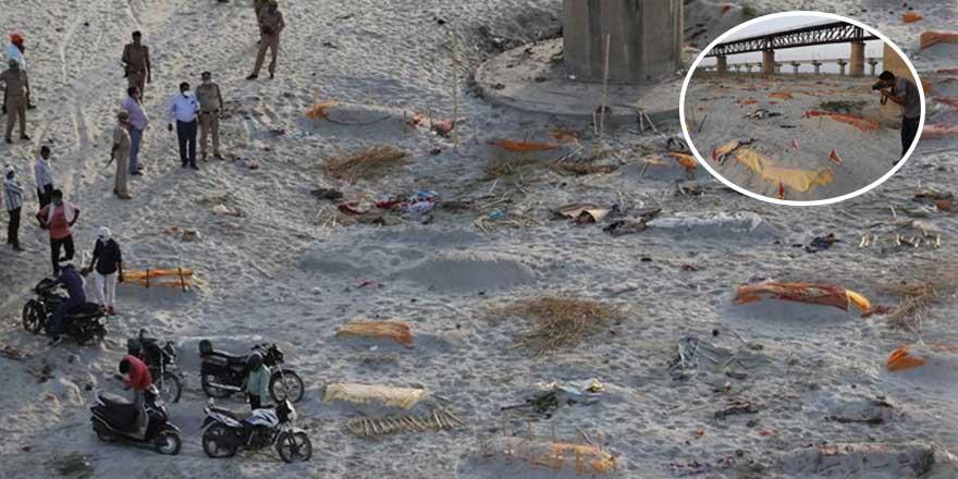 Ganj nehri kıyılarına gömülmüş yüzlerce cesedi ortaya çıkardı